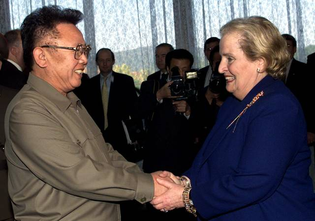 FILE - In this Oct. 23, 2000, file photo, North Korean Leader Kim Jong Il, left, shakes hands with U.S. Secretary of State Madeleine Albright at the Pae Kha Hawon Guest House in Pyongyang. President Donald Trump's Singapore summit with Kim Jong Un may be unprecedented, but during a quarter-century of on-off nuclear talks with North Korea, U.S. officials have learned a thing or two about dealing with an inscrutable adversary. (AP Photo/David Guttenfelder, Pool, File)