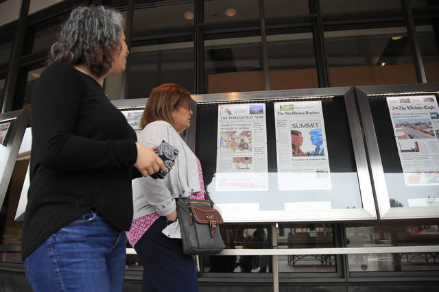 Newseum visitors browse newspaper front pages displayed outside the museum in Washington on Monday. There's substantial agreement on what Americans want from the news media and what journalists want to report, according to a pair of studies that also reveal a troubling caveat: a nagging feeling among both the ideal isn't being met.