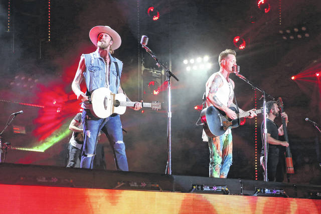 Brian Kelley, left, and Tyler Hubbard of Florida Georgia Line perform at the 2018 CMA Music Festival in Nashville, Tenn., on Sunday.