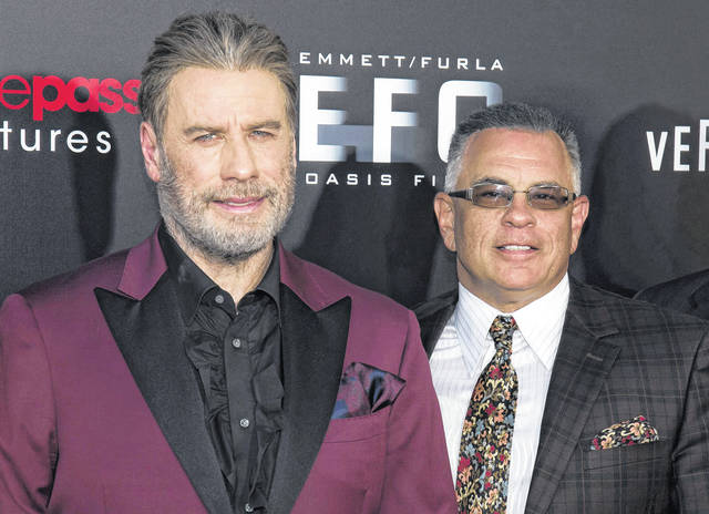 "John Travolta, left, and John Gotti, Jr. attend the premiere of ""Gotti"" at the SVA Theatre on Thursday in New York."