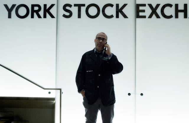 FILE- In this Jan. 2, 2018, file photo, a trader talks on his phone before the start of trading at the New York Stock Exchange. The U.S. stock market opens at 9:30 a.m. EDT on Monday, June 18.  (AP Photo/Mark Lennihan, File)