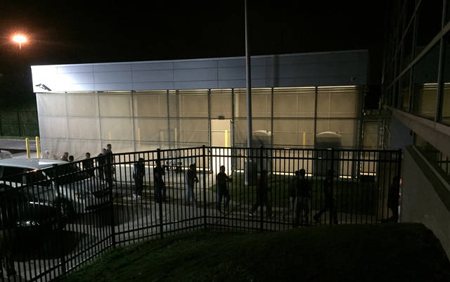 In this image provided by Jodie Bowers, detainees are escorted into an Immigration and Customs Enforcement (ICE) facility, early Wednesday, June 20, 2018, in Brooklyn Heights, Ohio. More than 100 workers were arrested Tuesday, at an Ohio meatpacking plant by federal agents following a yearlong immigration investigation, the second large-scale raid within the state in the past two weeks. (Jodie Bowers via AP)