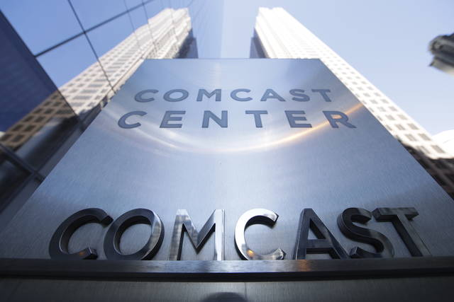 FILE - This March 29, 2017, file photo shows a sign outside the Comcast Center in Philadelphia. Disney is making a $70.3B counter bid for Fox's entertainment businesses following Comcast's $65 billion offer for the company. (AP Photo/Matt Rourke, File)