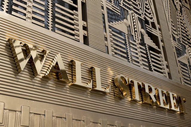 FILE- This April 24, 2018, file shows photo a sign for a Wall Street in New York. The U.S. stock market opens at 9:30 a.m. EDT on Wednesday, June 20. (AP Photo/Mark Lennihan, File)