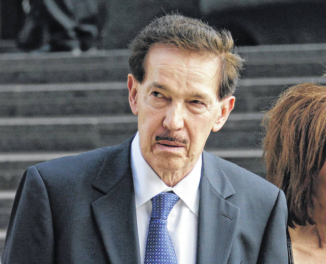 FILE - In this June 2, 2014, file photo, CEO of Suarez Corporation Industries, Benjamin Suarez leaves federal court in Cleveland after the first day of his trial on charges of violating campaign laws. An Ohio telemarketing company whose Republican owner, Suarez, spent more than a year in prison following a campaign finance probe has organized employees and suppliers in a retaliatory effort to bring down two prominent Democrats, The Associated Press has learned.