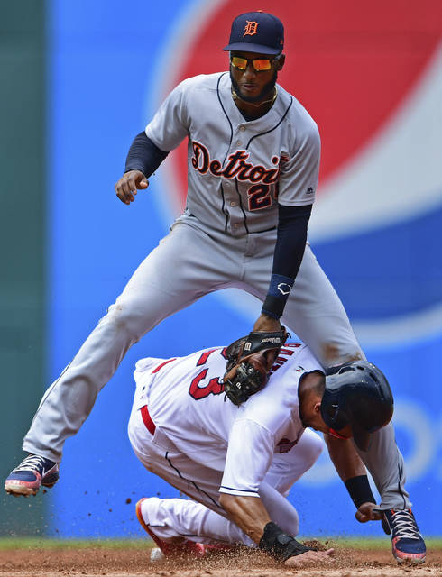Cleveland Indians' Michael Brantley, bottom, steals second as Detroit Tigers' Niko Goodrum is late on the tag in the second inning of a baseball game Sunday.