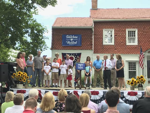 Republican Attorney General Mike DeWine introduces visitors to his annual ice cream social, Sunday in Cedarville, Ohio. DeWine's ice cream social wasn't just about dairy treats. It was also about making a show of force ahead of what's expected to be a tight race for Ohio's leading party this fall.
