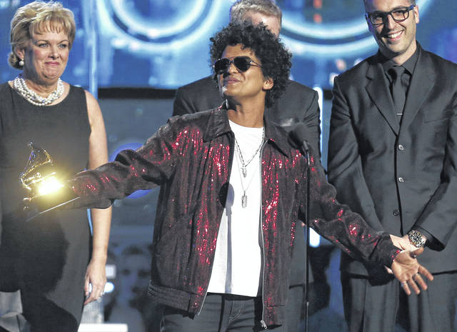 """Bruno Mars accepts the award for record of the year for """"24K Magic"""" on Jan. 28 at the 60th annual Grammy Awards in New York. The Grammy Awards are extending the number of nominees in its top categories from five to eight."""