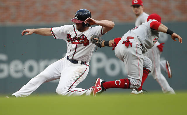 Atlanta Braves' Charlie Culberson, left, slides past the tag from Cincinnati Reds shortstop Jose Peraza to steal second base in the second inning of a baseball game Tuesday.
