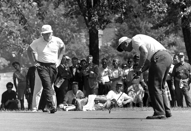 FILE - In this Sept. 14, 1960, file photo, Jack Nicklaus, right, drops a short putt on the 13th green to win, 6 and 5, his match with Phil Rodgers, left, in the morning round of the U.S. Amateur golf tournament at St. Louis. Rodgers, a five-time winner on the PGA Tour who became one of golf's top instructors, died after a long battle with leukemia. He was 80. Rodgers died Tuesday morning at his home near San Diego.