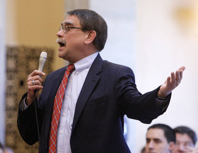 """FILE – In this March 2, 2011, file photo, Ohio state Sen. Bill Seitz discusses a bill about collective bargaining rights for public employees, during a floor debate in Columbus, Ohio. A law firm where Seitz worked for 36 years, retained by the state attorney general's office to independently investigate a complaint by a female House employee, concluded in April 2018 that the Republican lawmaker from Cincinnati had not violated the House's anti-harassment policy in remarks at an off-site party the employee claimed """"glorified a sexual harasser and minimized his victim and all victims of sexual harassment."""" (AP Photo/Jay LaPrete, File)"""