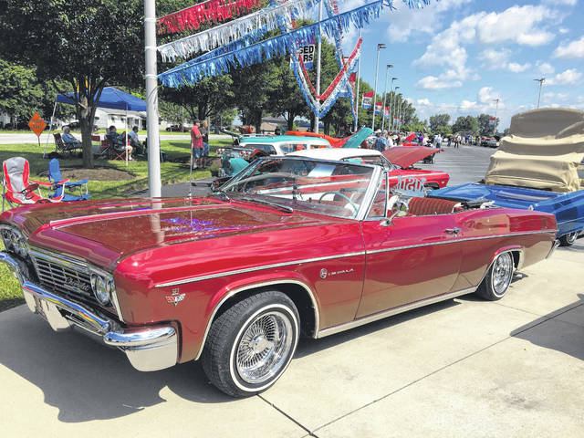 Jerry Lynch, of Wapakoneta, enjoys working on old cars, including his 1966 Chevy Impala Convertible.