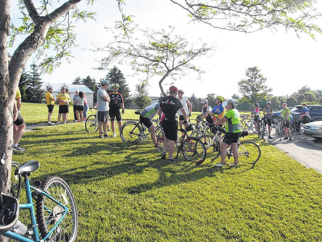 Bicyclists gather to talk during a past Limaland Bicycle Tour.