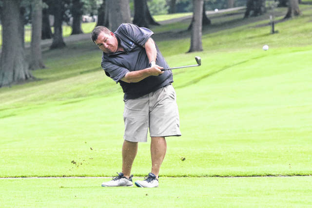 Josh Gaines follows through on his swing during the Second Flight at the Shawnee Country Club for the Lima City Golf Championship semi-final on Saturday evening.