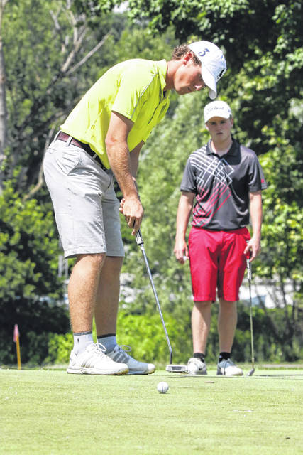 Cole Thomas eyes his putts during the Lima City Golf Championship Finals match at the Shawnee Country Club Sunday. Thomas collected the championship flight title.