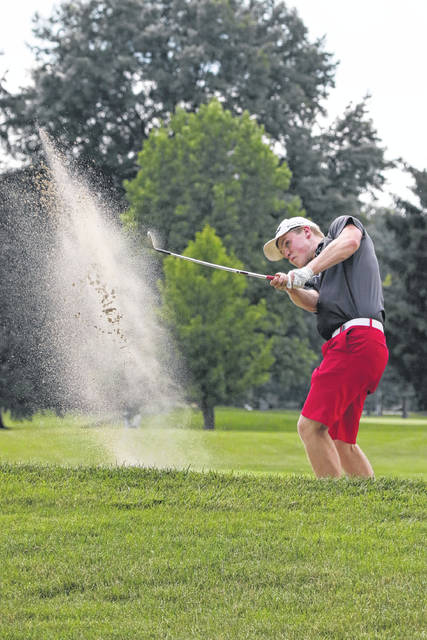 Spencer Stubbs digs himself out of a sand trap during the Lima City Golf Championship Finals match at the Shawnee Country Club Sunday.