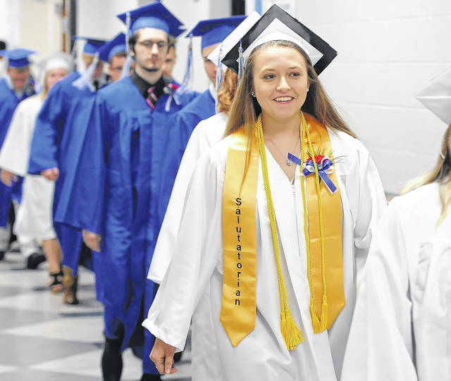 Students walk in to the Allen East 52nd graduation ceremony.