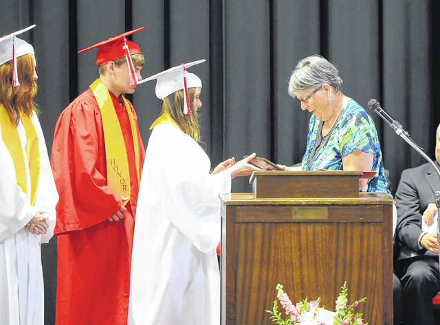 Delphos Jefferson students receive their diplomas during the ceremony.