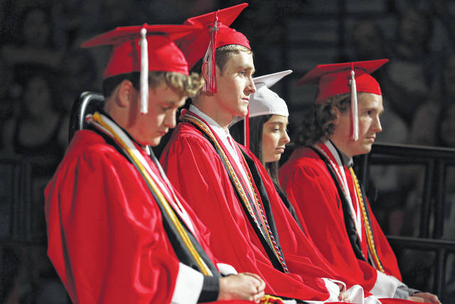 Honor speakers look on during the Wapakoneta High School graduation ceremony.