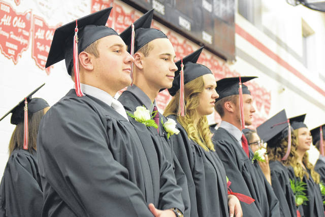 Columbus Grove graduates take their places in the gymnasium during the school's graduation ceremony.