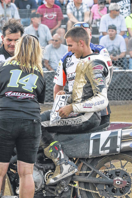 Briar Bauman talks with his pit crew Saturday night at the Allen County Fairgrounds.