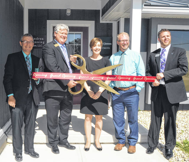 Dave Compton, Jed Metzger, Andrea Henning, Daniel Lee, and Jason May participate in ribbon cutting for the opening of Andrea Henning Law, LLC. 10 Devonshire Drive, Suite C, Monday.