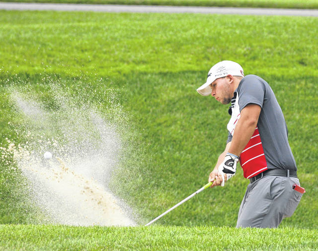 Aaron Belcher fires one out of the sand trap on the third hole Thursday during Lima City Men's Golf Championship match play competition at Hidden Creek Golf Club.