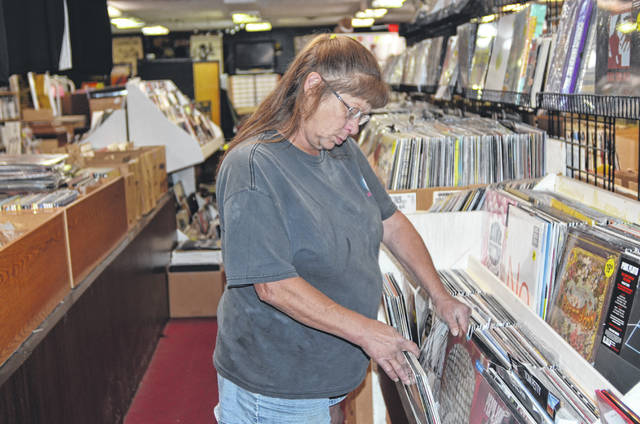 Sharon Frueh browses through the records at Groamy's CD's and Tapes on 1206 W. Robb Ave.