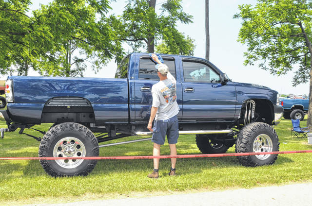 Ryan McCormick, a Lima 4-Wheel Jamboree participant of 22 years, polishes his car before the three-day weekend event Thursday at the Allen County Fairgrounds.