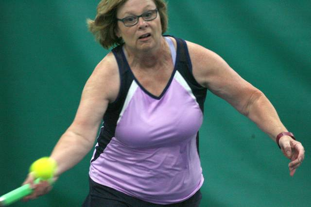 Joan Collar charges the net during singles action at the Lima Area Tennis Association tournament Saturday.