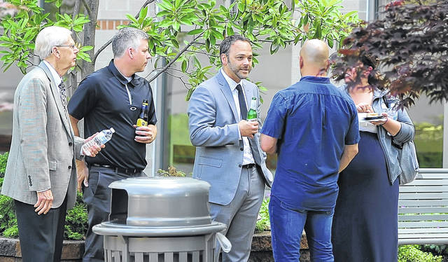 Members of the community met at rooftop garden of Mercy Health-St. Rita's Medical Center during Wednesday's Engage Lima. The event provided drink specials, appetizers and networking.