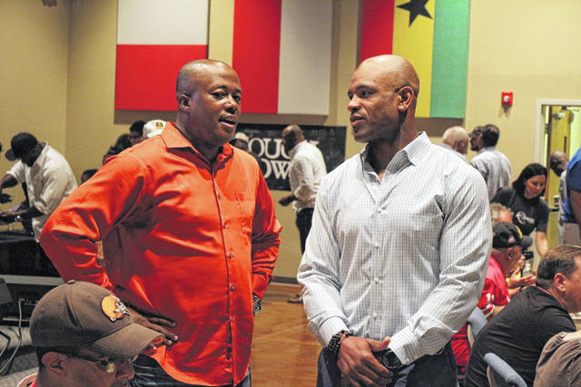 Administrative Pastor Herb Ford (left) talks with Akin Ayodele, former NFL linebacker, at a breakfast at Cornerstone Church in Lima.