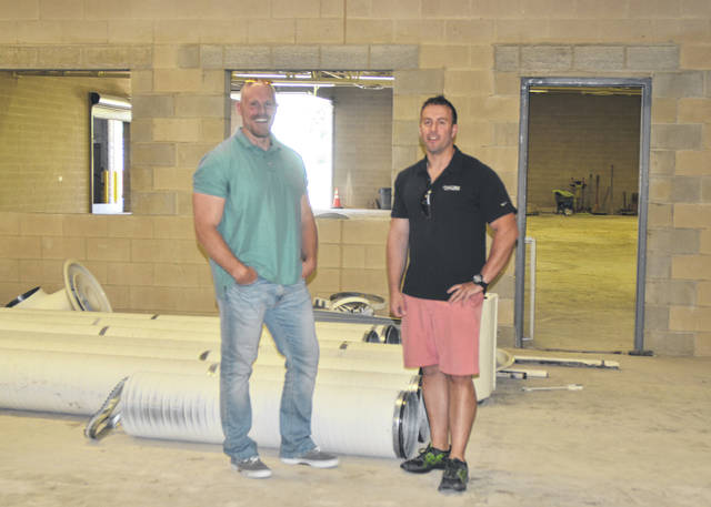 Impact Shooting Center owners Jeff Swinford and Dave Sabo stand in the shooting range area of the new shooting center, at 501 South Dixie Highway, the former site of Endless Endeavours.