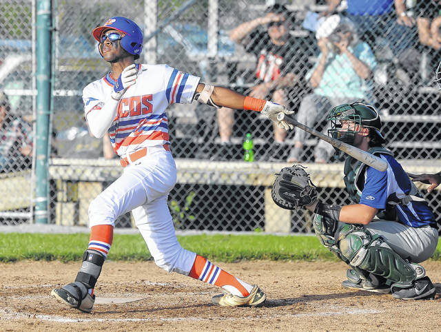 The Lima Locos' Justin Wiley hits a double during Thursday night's game against Grand Lake at Simmons Field. Looking on is Grand Lake catcher Logan Adams.