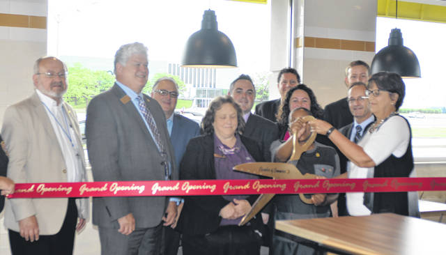 Lima Mayor David Berger, Jed Metzger, Jerry Lewis, Julie Crider, Jonathan Lewis, Tom Simon, Jessica Hall, Ryan Lowry, Cindy Tenwalde, Vivian Sites and Scott Shaw prepare for the ribbon cutting at the McDonald's on 2619 Elida Road Wednesday.