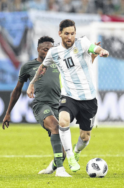 Argentina's Lionel Messi, front competes for the ball during the group D match between Argentina and Nigeria at the 2018 soccer World Cup in the St. Petersburg Stadium in St. Petersburg, Russia, Tuesday.