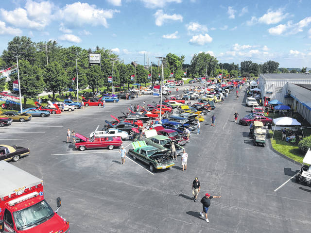 An overall shot of the 10th annual Charity Car Show held Sunday at the Lima Chevrolet Cadillac dealership on Cable Road.