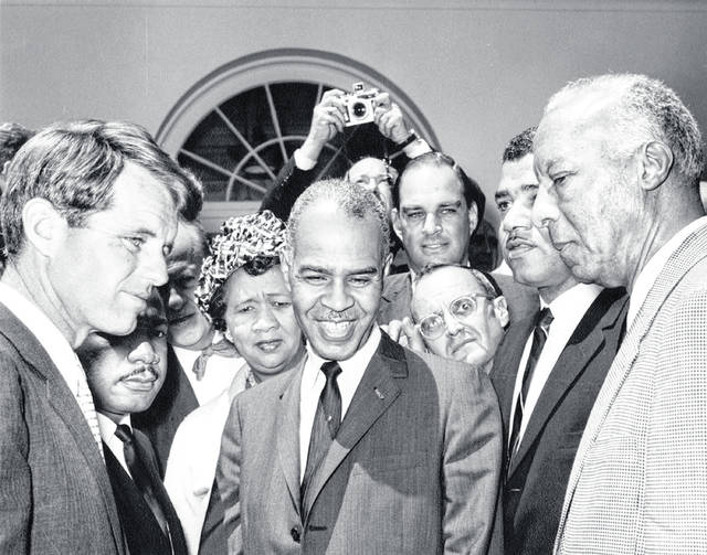 Attorney General Robert F. Kennedy meets with civil rights leaders in the Rose Garden of the White House, Washington, D.C. Left to right: Attorney General Kennedy; President of the Southern Christian Leadership Conference (SCLC), Dr. Martin Luther King, Jr. (partially hidden); President of the National Council of Negro Women, Dorothy Height; Executive Secretary of the National Association for the Advancement of Colored People (NAACP), Roy Wilkins; unidentified man (in front); attorney James H. Scheuer (in back); President of the National Urban League, Whitney M. Young, Jr.; President of the Negro American Labor Council (NALC), A. Philip Randolph. Photo |John F. Kennedy Presidential Library