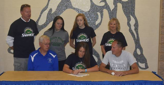Those present for Riley Newland of Allen East's signing a letter of intent to play softball for Spoon River College were Allen East Head Coach Paul Patton, Newland, her father, John, back row, Deron Newland, Jennifer Klear, Kate Newland and Barbara Newland. Submitted photo