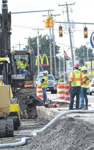 Road crews work to expand North West Street on Monday. Craig J. Orosz | The Lima News
