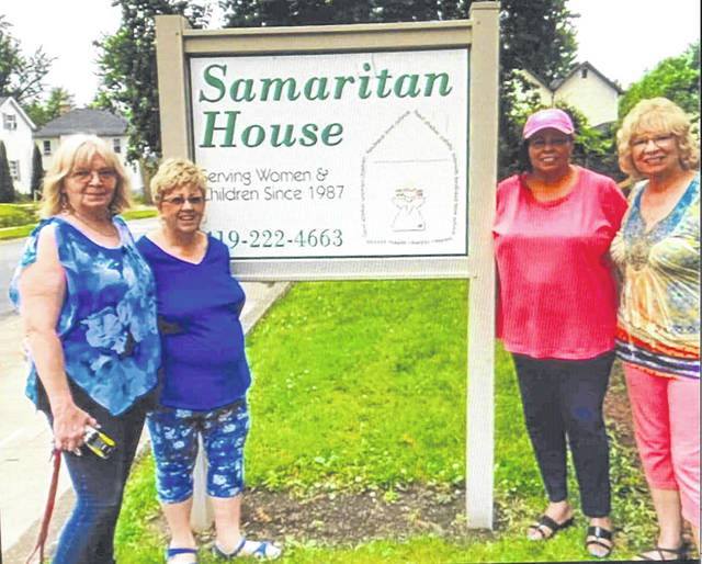 Left to rightnext to the sign are: Sharon Pitson, Samaritan House Manager, and Penny Hunt, Sandra Bentley, and Nancy Hustak from Altrusa checked out the newly installed carpet last week.