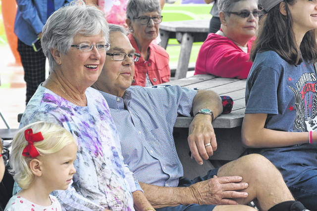 Saundra Neely, with her husband, Bruce, couldn't contain her surprise at being honored for her dedication in teaching people how to swim.