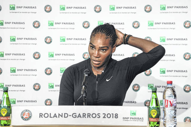 Serena Williams, of the U.S, answers journalists, at the Roland Garros stadium in Paris on Monday. Williams called off her Grand Slam comeback because of a chest muscle injury on Monday, pulling out of the French Open shortly before she was supposed to play Maria Sharapova in the fourth round.