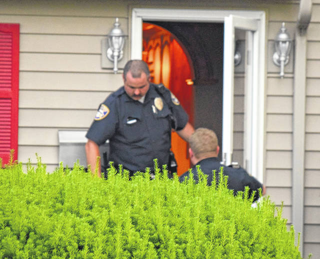 Members of the Van Wert Police Department are pictured at a residence at 830 Leeson Ave. in Van Wert, where an investigation is underway into the death of an infant there on Thursday.