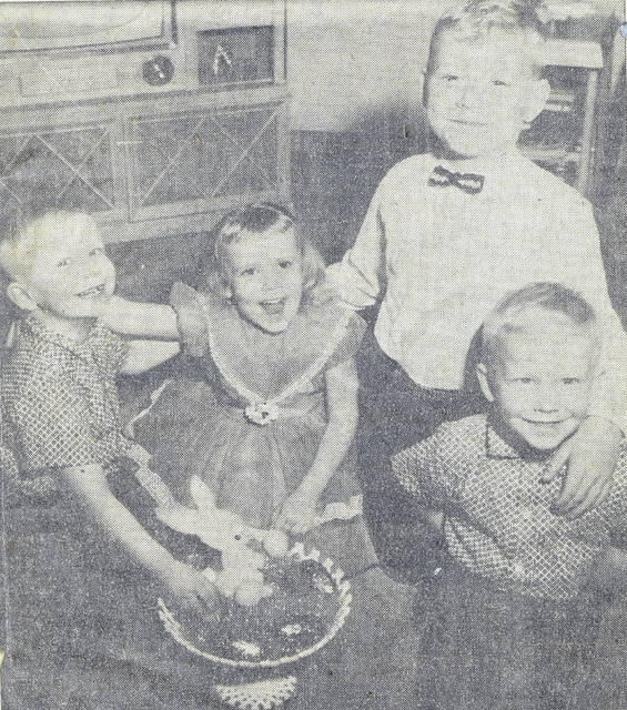 "This photo, published April 10, 1960, in The Lima News, shows four siblings who were celebrating April birthdays. They were the children of Mr. and Mrs. Norman Monfort. From left is Greg, 4, Kathy, soon to be 5, Eddie, 8, and Jeff, also 4. (Greg and Jeff are twins.) In the center, the family Easter basket symbolizes the children's birthday month. The Lima News staffer Bob Pendergast wrote a feature story on the family's birthday celebration, which included a big tour to visit all the grandparents. ""The Monforts are a typical Lima young couple who seem to be growing up with their blonde haired, blue eyed youngsters and 'although Norman and I don't have April birthdays, we get as much fun out of the big party as the kids,' says the mother. … The twins, who call each other Greg, forgetting that one is named Jeff, got cowboy suits for their birthday a week ago Saturday. Their sister wants a cowboy hat and boots next Saturday, when she makes the grade, and only Eddie's interest seems to turn to the sports' world. He got baseball equipment yesterday. That's the kind of present you'd expect on an April birthday."""