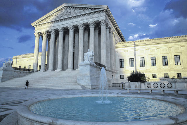 FILE - In this Oct. 10, 2017 file photo, the Supreme Court in Washington is seen at sunset. In a 5-4 decision Friday, The Supreme Court says police generally need a search warrant if they want to track criminal suspects' movements by collecting information about where they've used their cellphones.