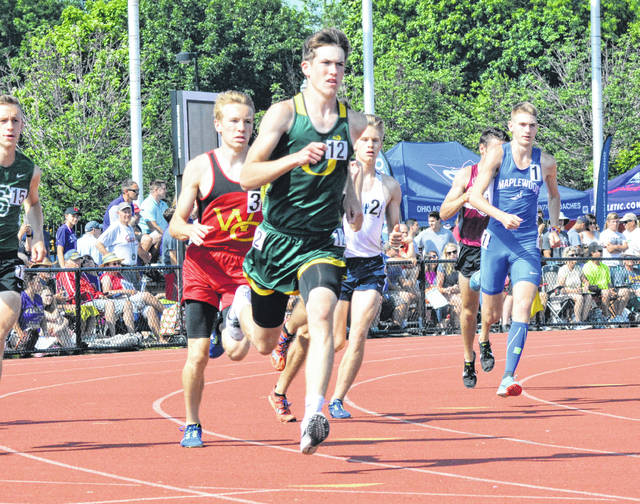 Ottoville's Brendan Siefker leads the way during Saturday's Division III 1,600 meter run at the state track and field championships at Ohio State's Jesse Owens Memorial Stadium in Columbus.