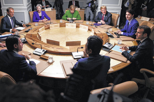 Clockwise from top left, President of the European Council Donald Tusk, British Prime Minister Theresa May, German Chancellor Angela Merkel, U.S. President Donald Trump, Canadian Prime Minister Justin Trudeau, French President Emmanuel Macron, Japanese Prime Minister Shinzo Abe and Italian Prime Minister Giuseppe Conte participate in a working session at the G-7 summit, Friday, June 8, 2018, in Charlevoix, Canada.