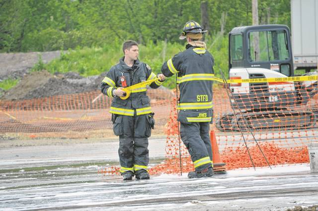 Shawnee Township firefighters tape off the area around an underground fuel storage tank that was the starting point of a fire at Shawnee Fuel Stop, 1250 W. Breese Road.