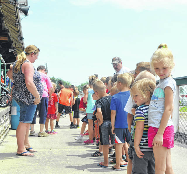 Children waiting in line for the Kiddie Tractor Pull Tuesday at the Putnam County Fair Kids Day.